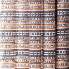 Catherine Lansfield Geometric Aztec Fully Lined Eyelet Curtains - Multi