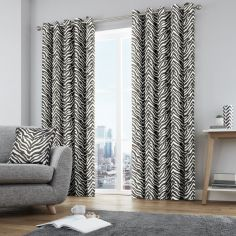 Zebra Print Fully Lined Eyelet Curtains - Black & White
